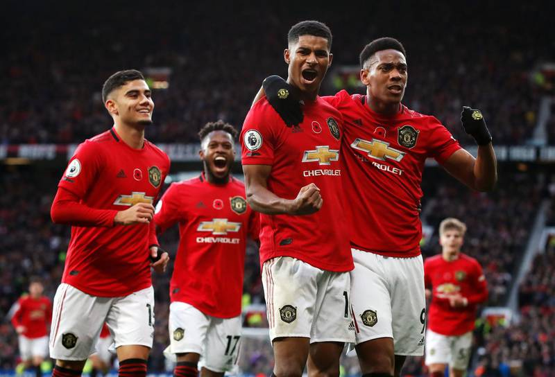 """Manchester United's Marcus Rashford (second right) celebrates scoring his side's third goal of the game with team-mates during the Premier League match at Old Trafford, Manchester. PA Photo. Picture date: Sunday November 10, 2019. See PA story SOCCER Man Utd. Photo credit should read: Martin Rickett/PA Wire. RESTRICTIONS: EDITORIAL USE ONLY No use with unauthorised audio, video, data, fixture lists, club/league logos or """"live"""" services. Online in-match use limited to 120 images, no video emulation. No use in betting, games or single club/league/player publications."""