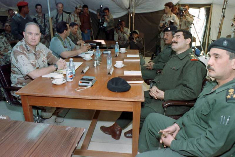 - FILE PHOTO 3MAR91 - File photo of Allied Forces Commander U.S. General Norman Schwarzkopf (L) meeting with Iraqi Lt-General Khalid Sultan Ahmed (2nd R) and other unidentified Iraqi commanders in Safwan occupied Iraq March 3, 1991. The meeting was to set conditions for cease fire and surrender ending the Gulf War. Iraq will mark on January 17 the 10th anniversay of the Gulf War that ended a seven month occupation of Kuwait.