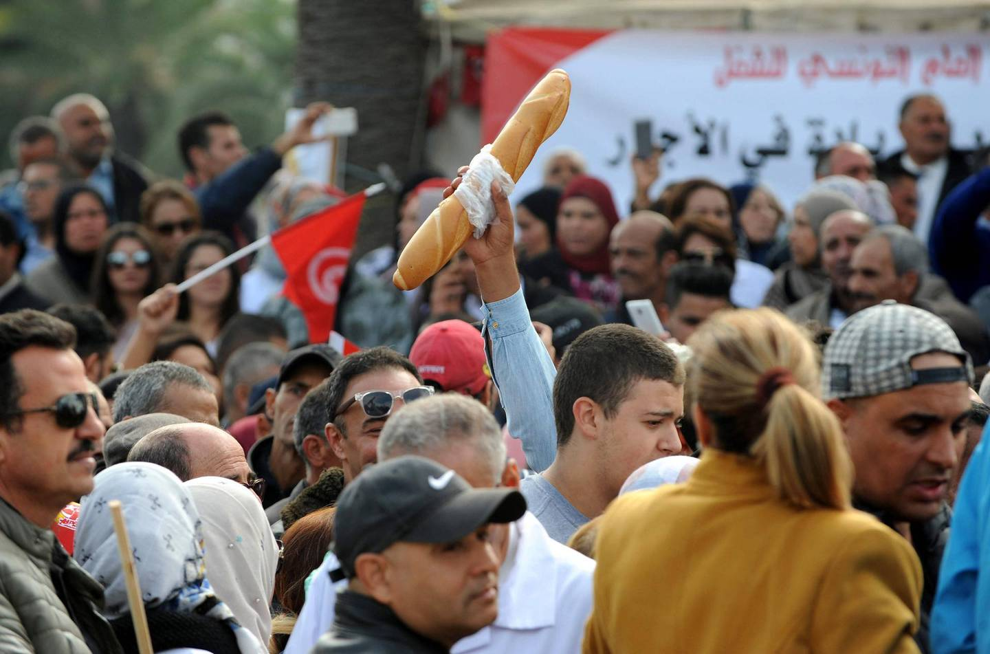epa07183168 People protest during a general strike in Tunis, Tunisia, 22 November 2018. Some 670 thousand civil servants went on strike on 22 November 2018 after the Tunisian General Labor Union (UGTT) and the Tunisia government failed to reach an agreement to increase the salaries by the government. Protesters said that the loan by the International Monetary Fund (IMF) to Tunisia was one of the main factors of the government refusal. Tunisia agreed in 2016 a 2.8 billion US dollars loan from the IMF. The general strike included all public sectors subjected to the civil service law, with minimum level of service guaranteed in vital sectors like emergency services.  EPA/STR