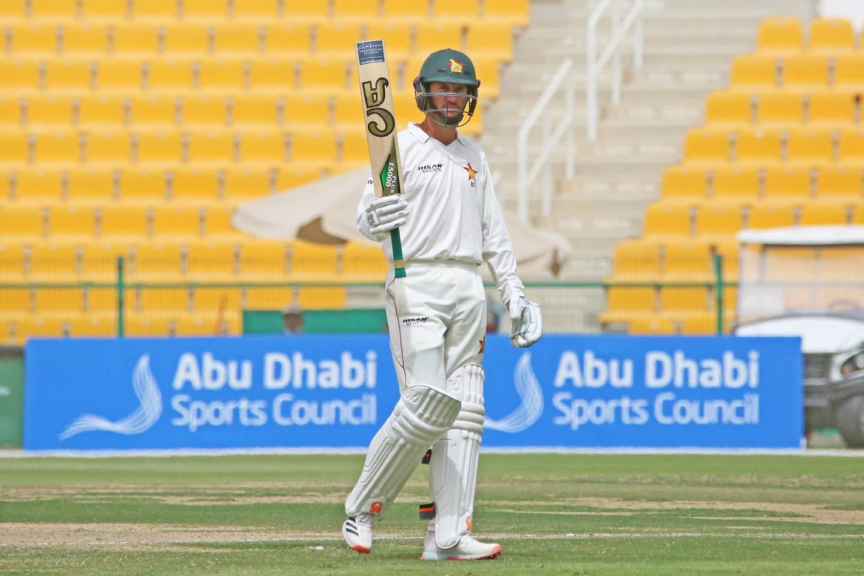 Zimbabwe captain Sean Williams salutes his teammates after reaching 50. Courtesy Abu Dhabi Cricket