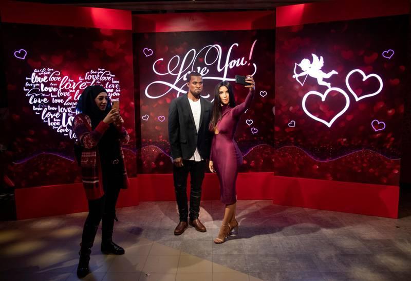 epa08217397 Visitors take a photo with the wax figures of Kim Kardashian and her Husband US rapper Kanye West at Madame Tussaud's in Istanbul, Turkey, 14 February 2020.  EPA-EFE/SEDAT SUNA