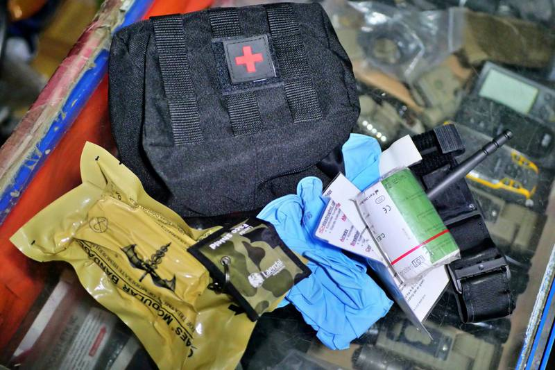 Pictured: The contents of an individual first aid kit sold at Mustafa's shop in central Kabul, including a tournique and a hemostatic dressing used to stop arterial bleeding. Photo by Charlie Faulkner