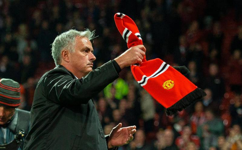 epa06977405 Manchester United manager Jose Mourinho reacts with a Manchester United scarf thrown from the crowd after the English Premier League soccer match between Manchester United and Tottenham at the Old Trafford in Manchester, Britain, 27 August 2018.  EPA/PETER POWELL