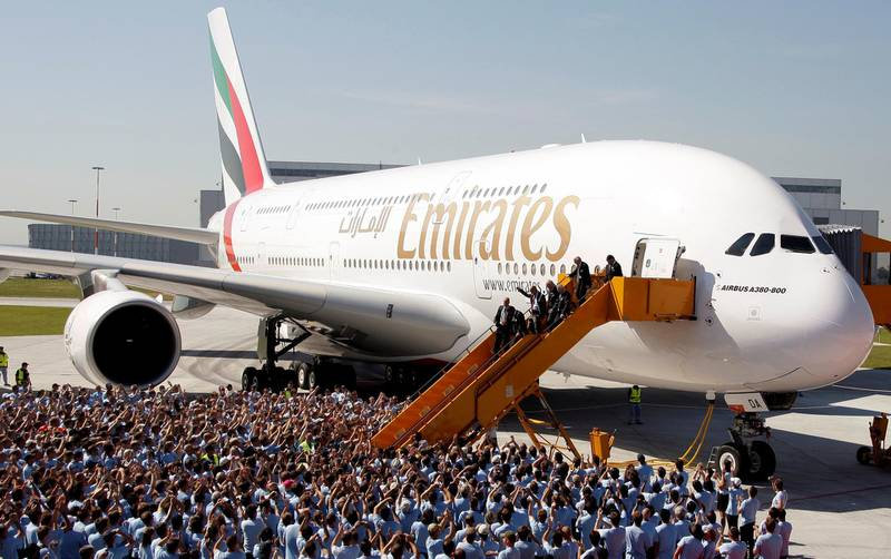 FILE PHOTO: Airbus CEO Tom Enders, Sheikh Ahmed bin Saeed al-Maktoum, chairman and chief executive of Emirates Airlines Group, and Louis Gallois, CEO of European Aeronautic Defence and Space company (EADS), disembark from an A380 aircraft during a handover ceremony in Hamburg, July 28, 2008.  REUTERS/Tobias Schwarz/File Photo