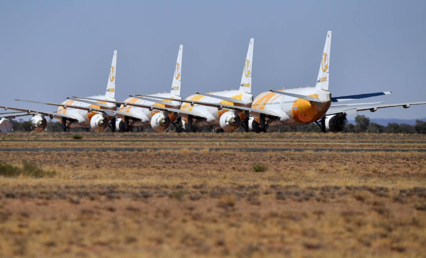 epa08654874 (FILE) - Boeing 787-8 Dreamliner airplanes of Singapore low-cost carrier Scoot Tigerair, grounded due to the Coronavirus (COVID-19) pandemic, are parked at the Asia Pacific Aircraft Storage facility in Alice Springs, Australia, 30 August 2020 (reissued 08 September 2020). US airplane manufacturer Boeing on 08 September 2020 announced that problems with the horizontal stabililzer are another issue slowing down the deliveries of the Dreamliner.  EPA/DARREN ENGLAND AUSTRALIA AND NEW ZEALAND OUT *** Local Caption *** 56307049
