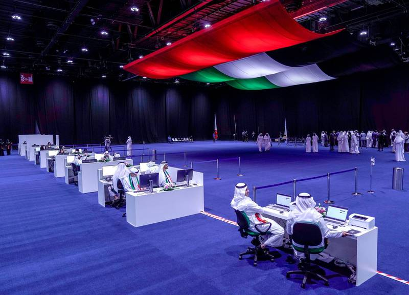 Abu Dhabi, United Arab Emirates, October 5, 2019.  FNC Elections at ADNEC. -- FNC volunteer organizers stand ready to assist voters at the floor.Victor Besa / The NationalSection:  NAReporter:  Haneen Dajani