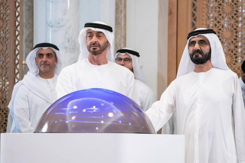 ABU DHABI, UNITED ARAB EMIRATES - January 08, 2020: HH Sheikh Mohamed bin Zayed Al Nahyan, Crown Prince of Abu Dhabi and Deputy Supreme Commander of the UAE Armed Forces (L) and HH Sheikh Mohamed bin Rashid Al Maktoum, Vice-President, Prime Minister of the UAE, Ruler of Dubai and Minister of Defence (R), launch the UAE National Brand logo, at Qasr Al Watan. Seen with HH Lt General Sheikh Saif bin Zayed Al Nahyan, UAE Deputy Prime Minister and Minister of Interior (back L).  ( Hamad Al Kaabi / Ministry of Presidential Affairs ) ---