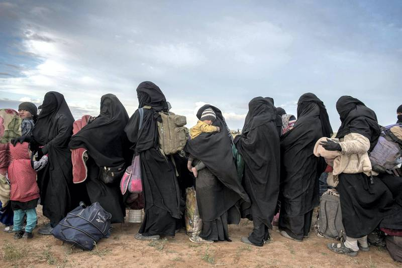Women and children wait to be screened after fleeing from the last pocket of ISIS territory outside Baghouz, 28 February 2019. Campbell MacDiarmid
