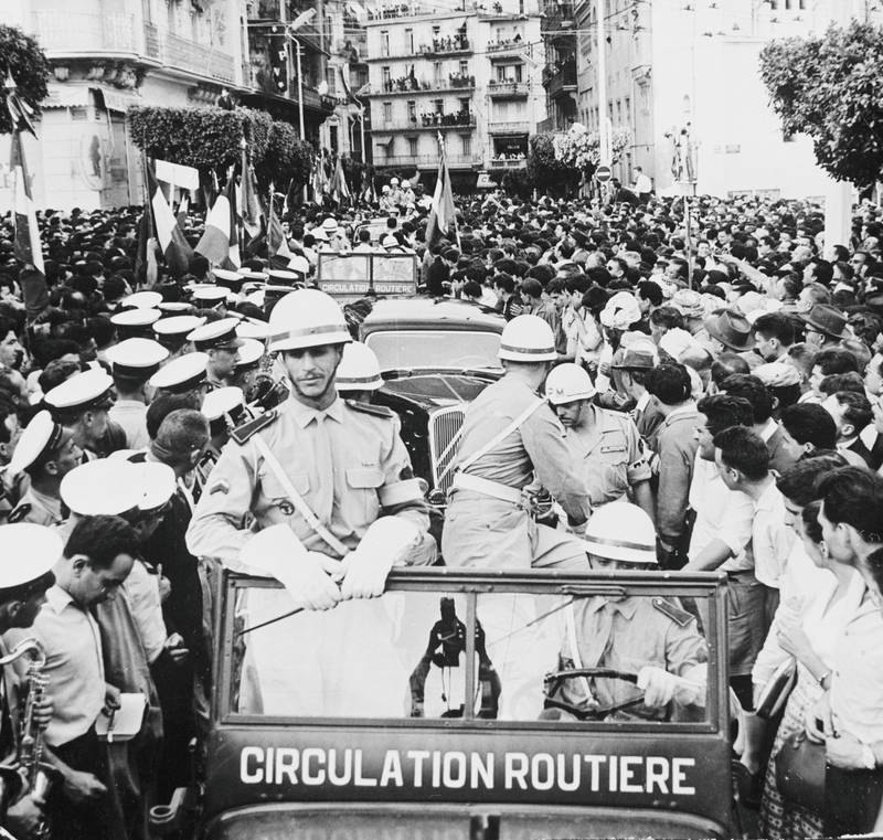 16th May 1958:  French military policemen in jeeps in a street at Algiers during the revolt by French officers under General Massu during the Algerian War of Independence.  (Photo by Keystone/Getty Images)