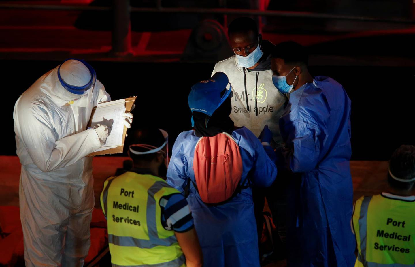 A rescued migrant is being checked by United Nations High Commissioner for Refugees (UNHCR) workers upon his arrival in Senglea, in Valletta's Grand Harbour, as the coronavirus disease (COVID-19) outbreak continues, Malta July 27, 2020. REUTERS/Darrin Zammit Lupi