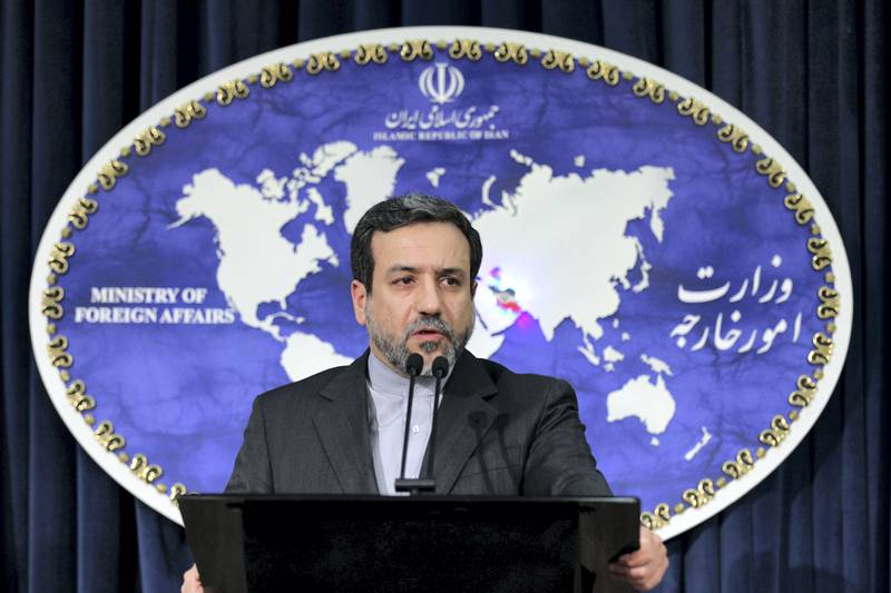 Newly appointed Iranian Foreign Ministry spokesman Abbas Araghchi addresses the room during a press conference in Tehran on May 14, 2013. AFP PHOTO/ATTA KENARE / AFP PHOTO / ATTA KENARE