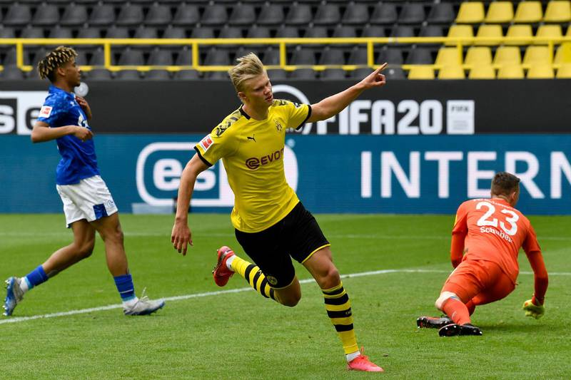 DORTMUND, GERMANY - MAY 16: Erling Haaland of Borussia Dortmund celebrates scoring his team's first goal during the Bundesliga match between Borussia Dortmund and FC Schalke 04 at Signal Iduna Park on May 16, 2020 in Dortmund, Germany. The Bundesliga and Second Bundesliga is the first professional league to resume the season after the nationwide lockdown due to the ongoing Coronavirus (COVID-19) pandemic. All matches until the end of the season will be played behind closed doors. (Photo by Martin Meissner/Pool via Getty Images)