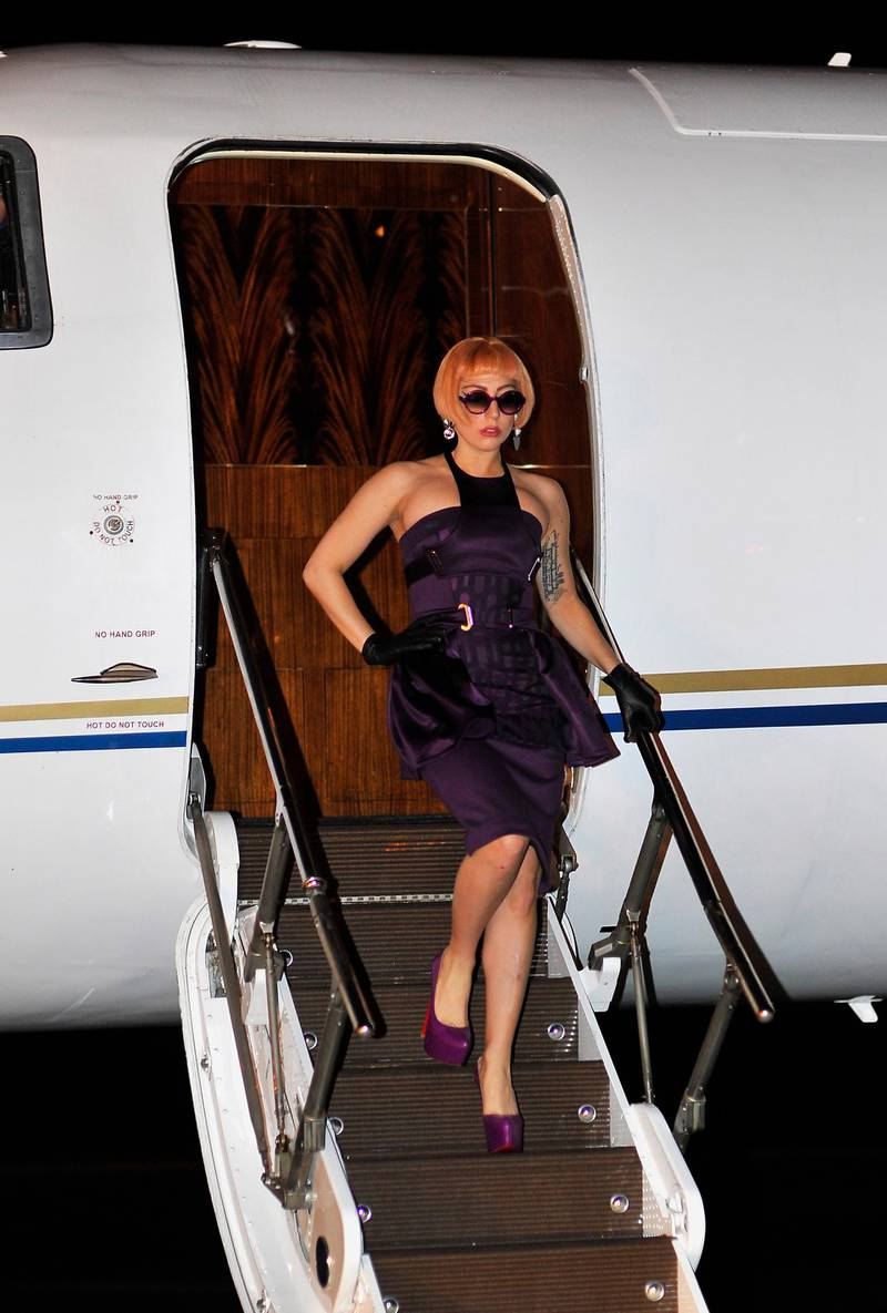 BRISBANE, AUSTRALIA - JUNE 11:  (EDITORS NOTE: Image has been reviewed by PR prior to transmission.) Lady Gaga arrives at Brisbane Airport ahead of her Australian tour, on June 11, 2012 in Brisbane, Australia.  (Photo by Marc Grimwade/Getty Images)
