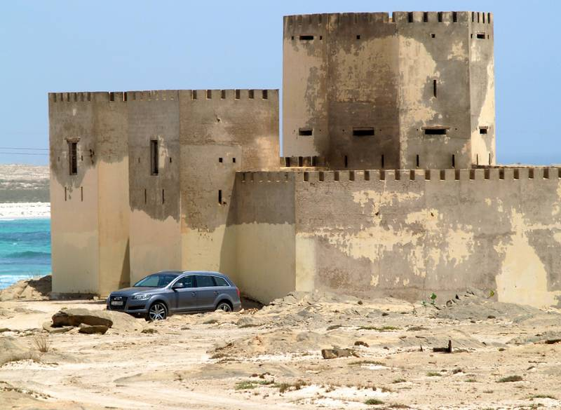 An Audi Q7 rests while its driver and passengers explore an abandoned fort near the sea in Mirbat, east of Salalah city - Paolo Rossetti for The National