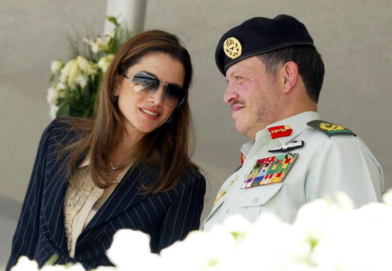AMMAN, JORDAN - JUNE 10:  Jordan's King Abdullah (R) and his wife Queen Rania attend a ceremony to mark Army Day at the Unknown Soldiers monument June 10, 2002 in Amman, Jordan. The King and his wife Queen Rania left June 10, 2002 for Brussels to start a European tour, that includes Britain and France, to look for support to revive peace talks between Israel and the Palestinians.  (Photo by Getty Images)