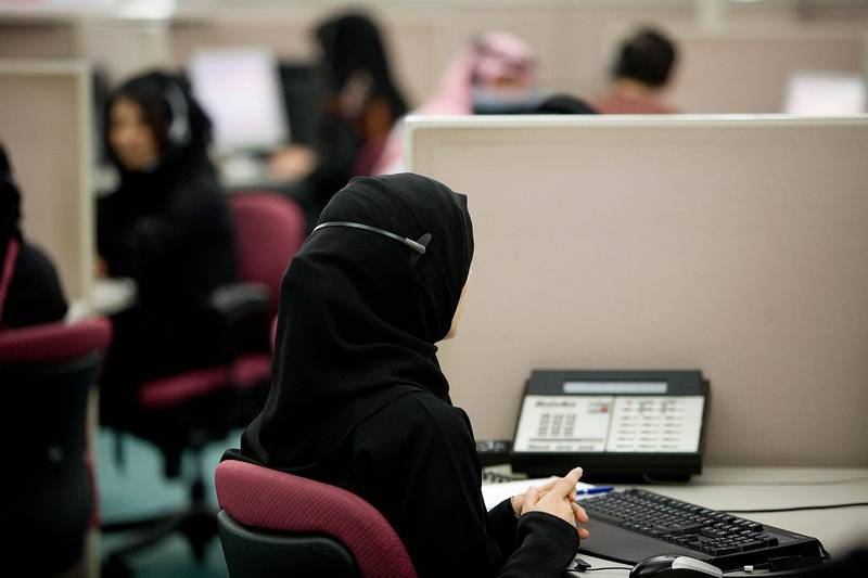 November 11, 2008 / Abu Dhabi / A Call Centre customer service representative assists a customer while at work, Tuesday, November 11, 2008 in the UAE. (Rich-Joseph Facun / The National) *** Local Caption *** rjf-1111-callcentre003.JPG