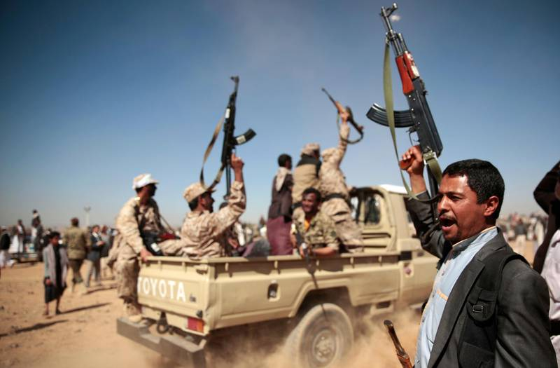 FILE - In this Jan. 3, 2017, file photo, a tribesman loyal to the Houthi rebels, right, chants slogans during a gathering aimed at mobilizing more fighters into battlefronts to fight pro-government forces in several Yemeni cities, in Sanaa, Yemen. Yemen's yearslong war between Shiite rebels and a Saudi-led coalition backing its exiled government has escalated with an assault on the insurgent-held port city of Hodeida. (AP Photo/Hani Mohammed, File)