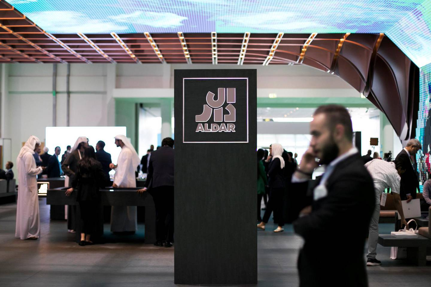 """ABU DHABI, UNITED ARAB EMIRATES - April 18 2019.Al Dar's booth, featuring """"Lea"""" at Cityscape Abu Dhabi 2019.The Abu Dhabi real estate developer is building a new waterfront residential project in the emirate as part of its recently adopted strategy to offer land plots for sale.The 'Lea' scheme is on the northern coast of Yas Island, where Abu Dhabi's Formula One racetrack, the Yas Marina, theme parks and several neighbourhoods including the adjoining Yas Acres development are located.(Photo by Reem Mohammed/The National)Reporter: Section: NA + BZ"""