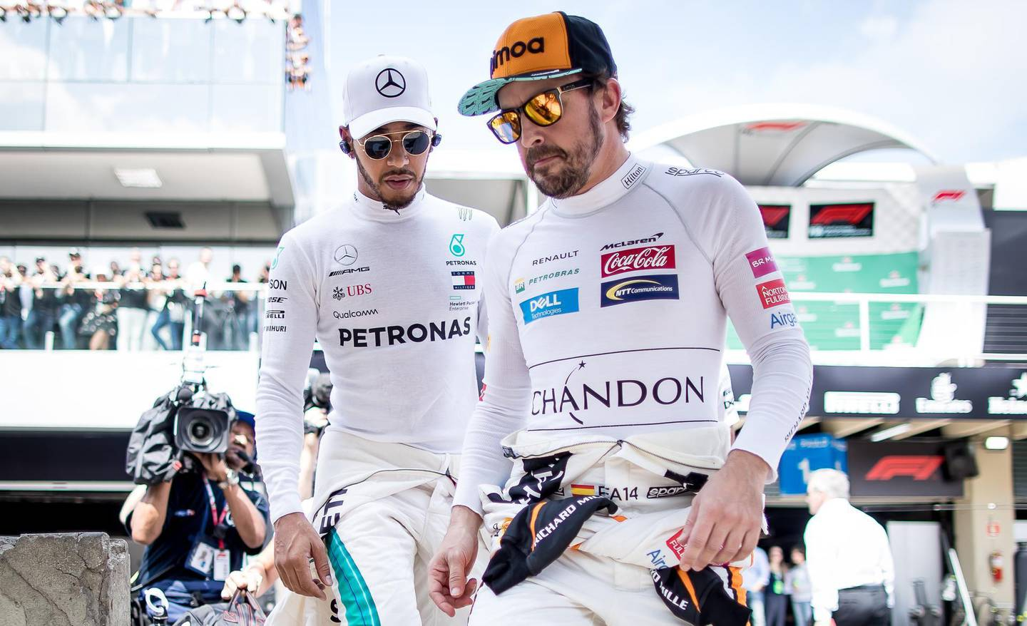 SAO PAULO, BRAZIL - NOVEMBER 11:  Fernando Alonso of Spain and McLaren F1 and Lewis Hamilton of Great Britain and Mercedes GP walk to the grid before the Formula One Grand Prix of Brazil at Autodromo Jose Carlos Pace on November 11, 2018 in Sao Paulo, Brazil.  (Photo by Lars Baron/Getty Images)