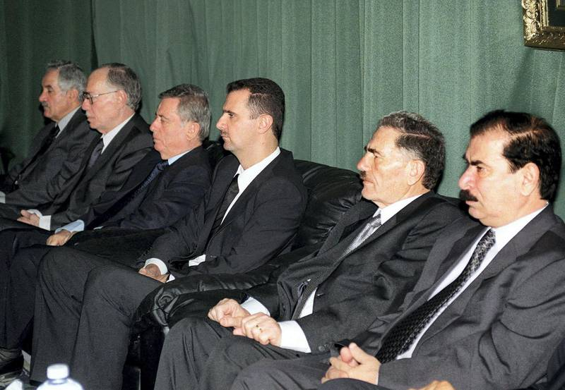 """(FILES) In this file handout photo provided by the Syrian Arab News Agency SANA on June 14, 2000, (From R to L) then Syrian vice-president Zuheir Masharqa, deputy secretary General of the Syrian Baath Party Abdallah al-Ahmar, Syrian heir apparent Bashar al-Assad, vice-president Abdel Halim Khaddam, parliament speaker Abdel Qader Qadura and Baath Party senior member, Suleiman Qaddah, sit during condolences in the Assads' hometown of Qerdaha in northern Syria. - President Bashar al-Assad, whose family has ruled Syria for over half a century, faces an election this week meant to cement his image as the only hope for recovery in the war-battered country, analysts say. (Photo by - / SANA / AFP) / == RESTRICTED TO EDITORIAL USE - MANDATORY CREDIT """"AFP PHOTO / HO / SANA"""" - NO MARKETING NO ADVERTISING CAMPAIGNS - DISTRIBUTED AS A SERVICE TO CLIENTS =="""