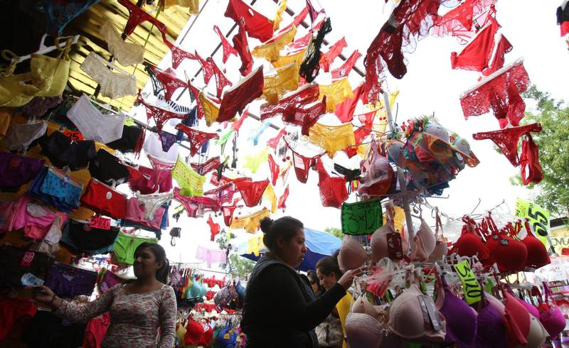 Mandatory Credit: Photo by Mario Guzman/EPA/Shutterstock (8079232a)Yellow and Red Underwear is For Sale on a Street in Mexico City Mexico 30 December 2015 Wearing Red and Yellow Underwear and Eating Twelve Grapes One For Each Month of the Year Are Part of the Traditions For Mexican People on New Year's Eve Mexico Mexico CityMexico New Year Traditions - Dec 2015