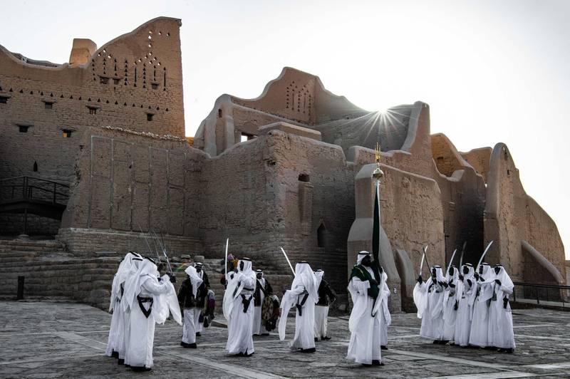 Traditional Saudi Ardah dance in front of Salwa Palace in At-Turaif in Ad Diriyah. Photo by THAMER AL AHMADI