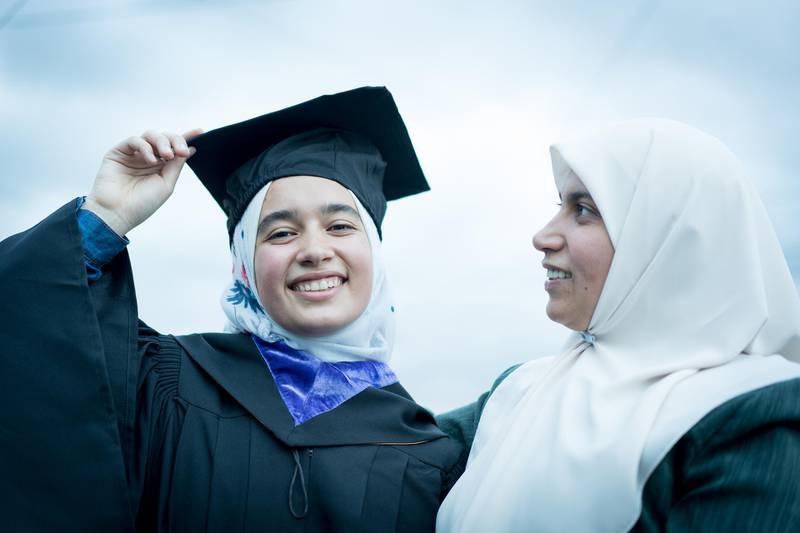 Closeup portrait of Arab Muslim teen girl during graduation ceremony
