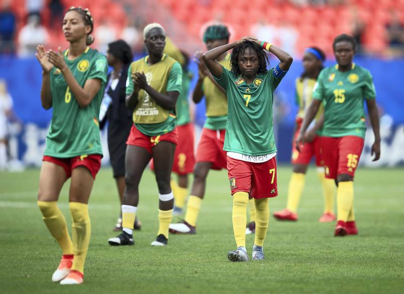 VALENCIENNES, FRANCE - JUNE 23: Gabrielle Aboudi Onguene of Cameroon looks dejected following the 2019 FIFA Women's World Cup France Round Of 16 match between England and Cameroon at Stade du Hainaut on June 23, 2019 in Valenciennes, France. (Photo by Marc Atkins/Getty Images)