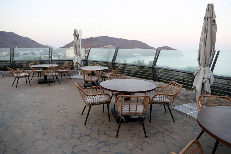SHARJAH , UNITED ARAB EMIRATES , December 21– 2020 :-  Outside sitting area of the restaurant at the Khor Fakkan amphitheatre in Sharjah. ( Pawan Singh / The National ) For News/Standalone/Instagram/Big Picture.