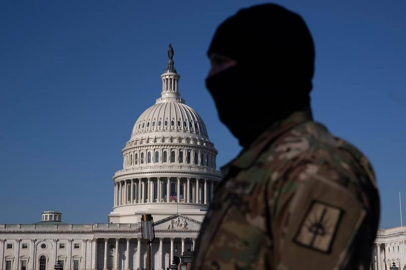 epa08933147 A member of the US National Guard stands on the grounds of the East Front of the US Capitol in Washington, DC, USA, 12 January 2021. At least ten thousand troops of the National Guard will be deployed in Washington by the end of the week, with the possibility of five thousand more, to help secure the Capitol area ahead of more potentially violent unrest in the days leading up to the Inauguration of US President-elect Biden. Democrats are attempting to impeach incumbent US President Trump after he incited a mob of his supporters to riot on the US Capitol in an attempt to thwart Congress from certifying Biden's election victory.  EPA/MICHAEL REYNOLDS