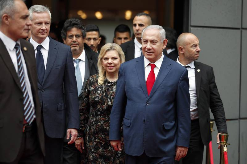 Israel's Prime Minister Benjamin Netanyahu and his wife Sara Netanyahu walk out after their meeting with French Finance Minister Bruno Le Maire, second left, at Bercy Economy Ministry, in Paris, Wednesday, June 6, 2018. Netanyahu met French Finance Minister Bruno Le Maire, who is pushing to maintain European trade with Iran allowed under the 2015 deal curbing Iranian nuclear activities.(AP Photo/Francois Mori)