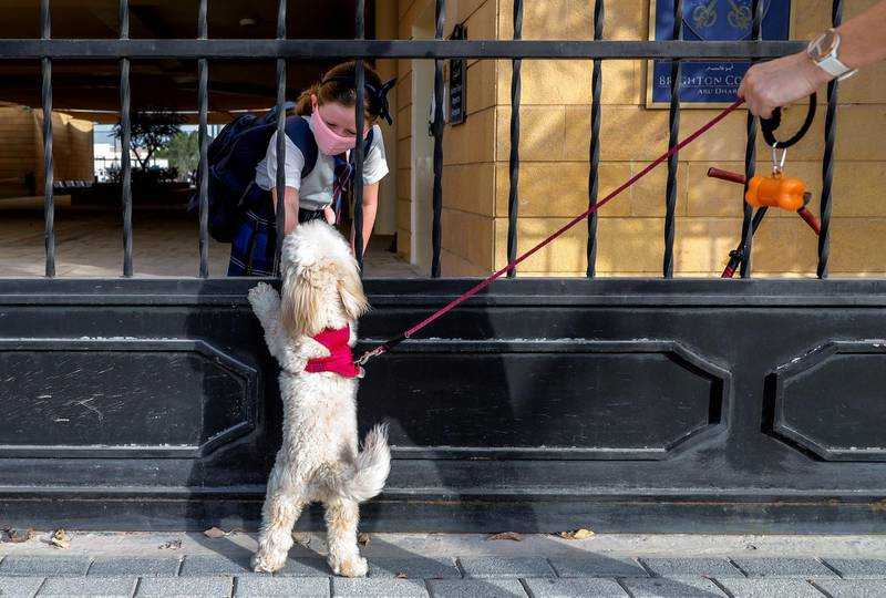 Abu Dhabi, United Arab Emirates, August 30, 2020.  Children return to school on Sunday after months off due to the Covid-19 pandemic at the Brighton College, Abu Dhabi. --  Darcey Clement, nine,  says goodbye to her dog Bella, before going to class.Victor Besa /The NationalSection:  NAReporter:  Haneen Dajani