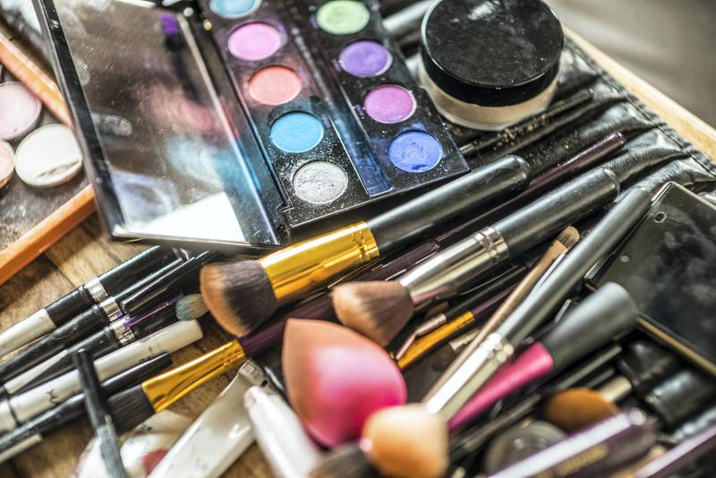 detail of make up brushes and powder