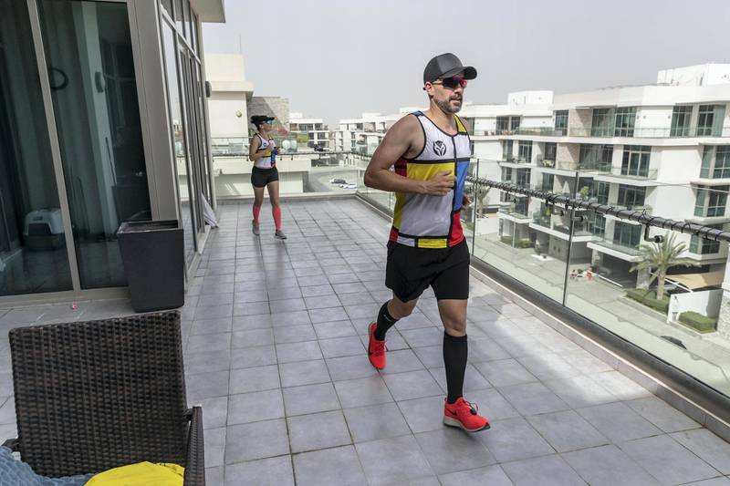 DUBAI, UNITED ARAB EMIRATES. 28 MARCH 2020. Colin and his wife Hilda are running a marathon on their balcony while the City of Dubai is under a Stay At Home policy to keep residence safe from the spread of Covid-19. (Photo: Antonie Robertson/The National) Journalist: Patrick Ryan. Section: Business.