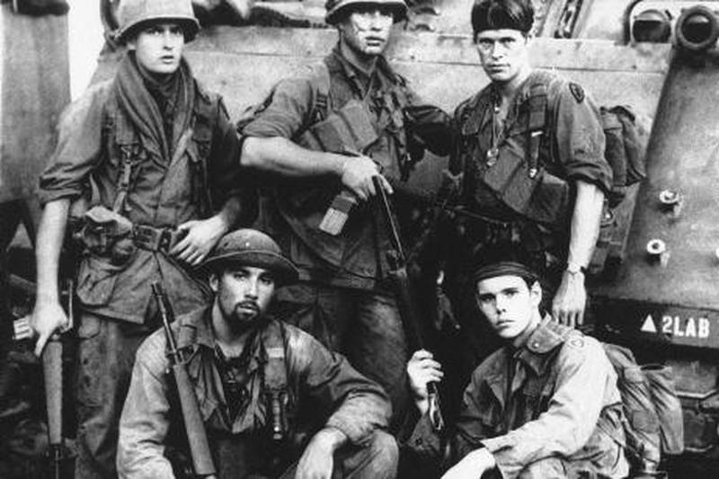 """In this publicity image released by Metro Goldwyn Mayer/Orion Pictures, top row from left, Charlie Sheen, Tom Berenger, Willem Dafoe, from bottom left, Francesco Quinn and Kevin Dillon is shown in a scene from """"Platoon."""" (AP Photo/Metro Goldwyn Mayer/Orion Pictures)"""