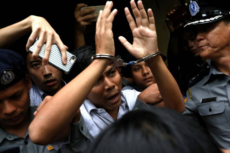 Reuters journalist Kyaw Soe Oo departs Insein court after his verdict announcement in Yangon, Myanmar, September 3, 2018. REUTERS/Ann Wang