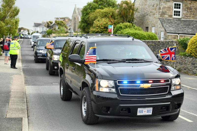 The motorcade of US President Joe Biden is driven through Carbis Bay, Cornwall on June 10, 2021, ahead of the three-day G7 summit being held from 11-13 June.  G7 leaders from Canada, France, Germany, Italy, Japan, the UK and the United States meet this weekend for the first time in nearly two years, for the three-day talks in Carbis Bay, Cornwall. -   / AFP / Oli SCARFF