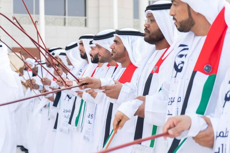 ABU DHABI, UNITED ARAB EMIRATES - October 12, 2019: Traditional Ayalah dancers participate in a homecoming reception for UAE Astronauts Hazza Ali Al Mansoori and Sultan Saif Al Neyadi, at the Presidential Airport.   ( Rashed Al Mansoori / Ministry of Presidential Affairs ) ---