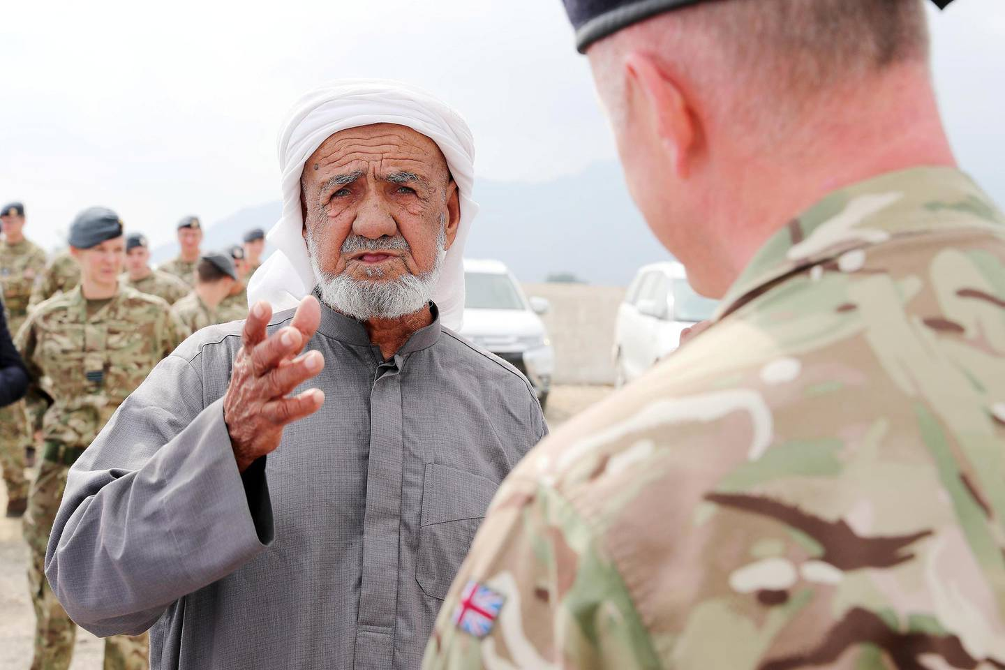 FUJAIRAH , UNITED ARAB EMIRATES , FEB 14  – 2018 :- Mohamed Homoud Hazzaa Alsereidi , Emirati talking to Captain Jim Lowther from Royal Navy , Defence Attaché , Abu Dhabi during the interview after the memorial service of William Henry Donnelly , Sergeant , Royal Air Force who was died on 14 February 1943 after his Wellington Bomber crashed during the WW2 in Fujairah. Mohamed Homoud Hazzaa Alsereidi was young boy when the plane was crashed near his village. ( Pawan Singh / The National ) For News. Story by John