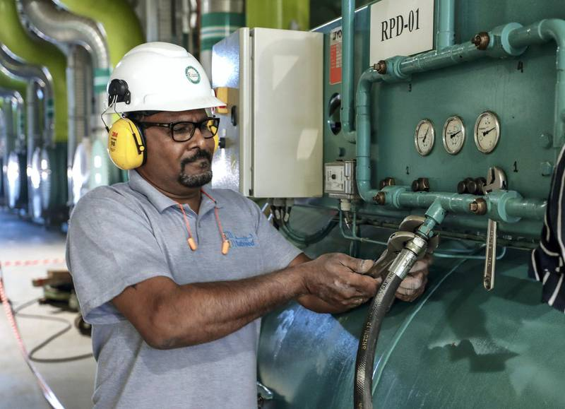 Abu Dhabi, United Arab Emirates, January 7, 2020.  STORY BRIEF:  Tabreed media tour of  YAS Sustainable Cooling Plant 01.--  An engineer tightens valves of a refrigerant refiller unit.Victor Besa / The NationalSection:  BZReporter:   Fareed Rahman