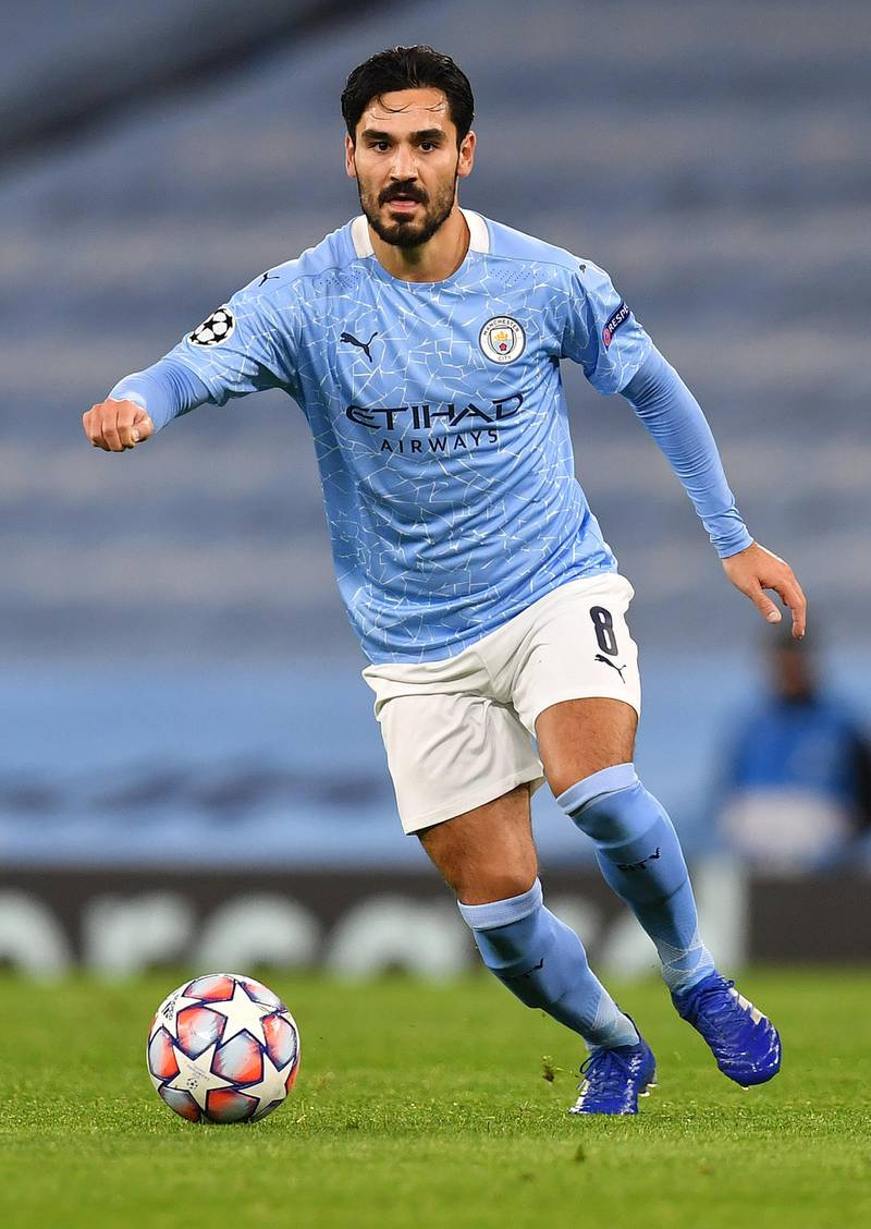 Manchester City's German midfielder Ilkay Gundogan runs with the ball during the UEFA Champions League football Group C match between Manchester City and Olympiakos at the Etihad Stadium in Manchester, north west England on November 3, 2020. (Photo by Paul ELLIS / AFP)