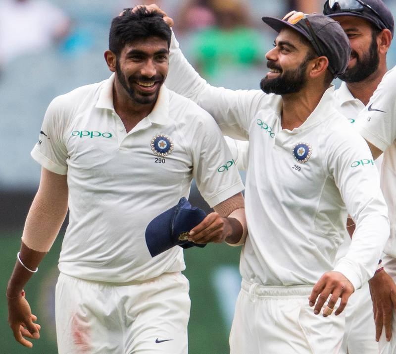 India's captain Virat Kohli, right, celebrates Jasprit Bumrah, left, after Bumrah got the wicket of Australia's Shaun Marsh during play on day three of the third cricket test between India and Australia in Melbourne, Australia, Friday, Dec. 28, 2018. (AP Photo/Asanka Brendon Ratnayake)