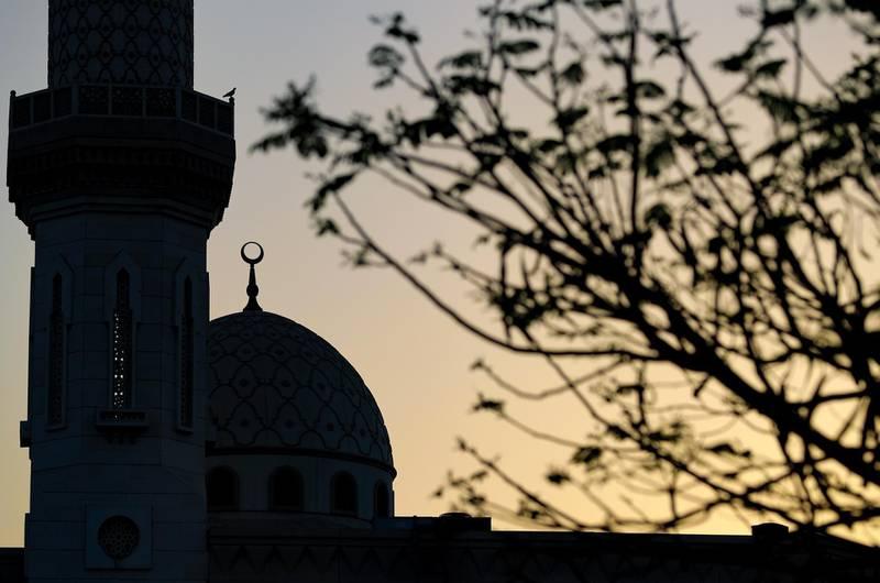 Dubai, United Arab Emirates - Reporter: N/A. News. The sun sets over a mosque on the last evening before Ramadan in Dubai. Monday, April 12th, 2021. Dubai. Chris Whiteoak / The National