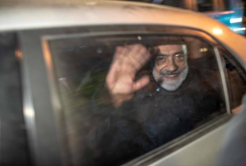Journalist and writer Ahmet Altan waves in a car as he is detained on November 12, 2019, at Kadikoy neighbourhood in Istanbul. A Turkish court on November 12 ordered the arrest of prominent journalist Ahmet Altan just a week after his release from prison over alleged links to the failed 2016 coup, state media reported. / AFP / BULENT KILIC