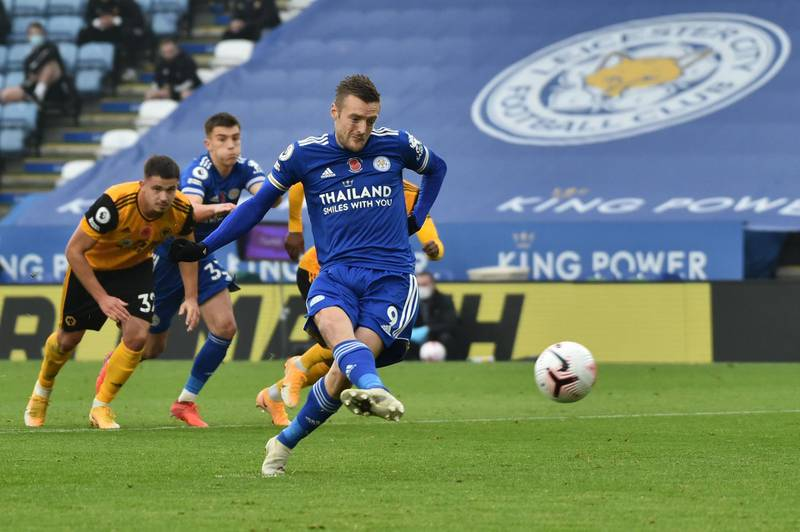 Leicester City's English striker Jamie Vardy scores the opening goal from the penalty spot during the English Premier League football match between Leicester City and Wolverhampton Wanderers at King Power Stadium in Leicester, central England on November 8, 2020. RESTRICTED TO EDITORIAL USE. No use with unauthorized audio, video, data, fixture lists, club/league logos or 'live' services. Online in-match use limited to 120 images. An additional 40 images may be used in extra time. No video emulation. Social media in-match use limited to 120 images. An additional 40 images may be used in extra time. No use in betting publications, games or single club/league/player publications.  / AFP / POOL /  Rui Vieira                          / RESTRICTED TO EDITORIAL USE. No use with unauthorized audio, video, data, fixture lists, club/league logos or 'live' services. Online in-match use limited to 120 images. An additional 40 images may be used in extra time. No video emulation. Social media in-match use limited to 120 images. An additional 40 images may be used in extra time. No use in betting publications, games or single club/league/player publications.