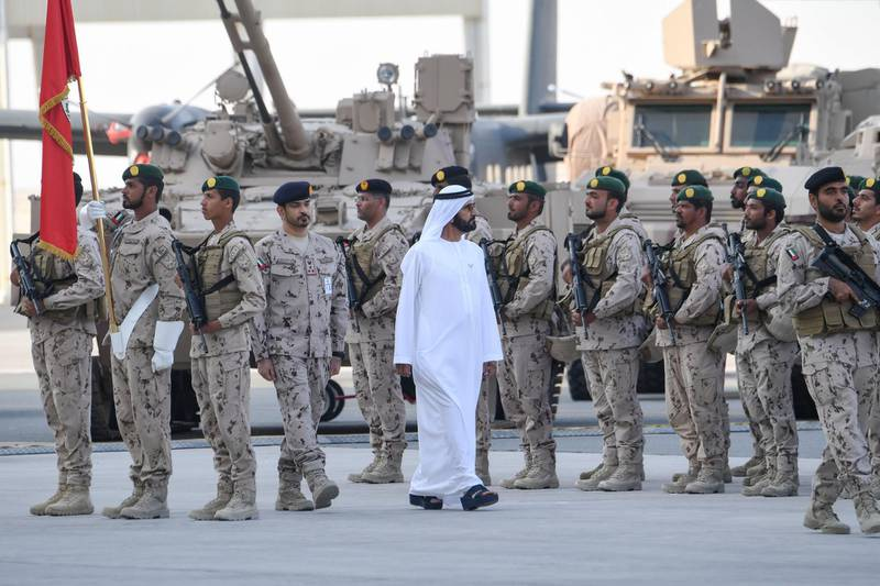 """A handout image provided by the UAE Ministry of Presidential Affairs on February 9, 2020, shows Sheikh Mohamed bin Rashid al-Maktoum, Vice President and Prime Minister of the United Arab Emirates , and ruler of the Emirate of Dubai, walking past military personnel during a reception to celebrate members of the UAE Armed Forces who served in the Arab coalition in Yemen, at Zayed Military City in Abu Dhabi. (Photo by - / Ministry of Presidential Affairs / AFP) / RESTRICTED TO EDITORIAL USE - MANDATORY CREDIT """"AFP PHOTO / MINISTRY OF PRESIDENTIAL AFFAIRS-UAE"""" - NO MARKETING - NO ADVERTISING CAMPAIGNS - DISTRIBUTED AS A SERVICE TO CLIENTS"""
