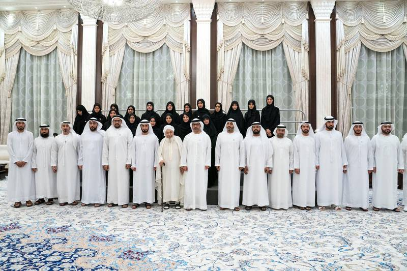 ABU DHABI, UNITED ARAB EMIRATES - May 15, 2019: HH Sheikh Hamed bin Zayed Al Nahyan, Chairman of the Crown Prince Court of Abu Dhabi and Abu Dhabi Executive Council Member (front row 8th L), stands for a group photograph with members of the General Authority for Islamic Affairs and Endowments., during an iftar reception at Al Bateen Palace. Seen with HE Shaykh Abdallah bin Bayyah (front row 7th L) and HE Dr Mohamed Matar Salem bin Abid Al Kaabi, Chairman of the UAE General Authority of Islamic Affairs and Endowments (front row 9th L).  ( Eissa Al Hammadi for the Ministry of Presidential Affairs ) ---