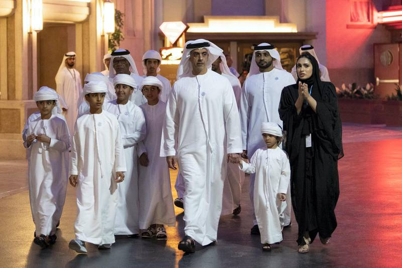 YAS ISLAND, ABU DHABI, UNITED ARAB EMIRATES - July 23, 2018: HH Lt General Sheikh Saif bin Zayed Al Nahyan, UAE Deputy Prime Minister and Minister of Interior (3rd R), attends the opening of Warner Bros World Abu Dhabi. Seen with HH Sheikh Zayed bin Hamed bin Zayed Al Nahyan, HH Sheikh Saif bin Hamed bin Zayed Al Nahyan, HH Sheikh Ahmed bin Hamed bin Zayed Al Nahyan and other young dignitaries. .   ( Eissa Al Hammadi for The Crown Prince Court ) ---