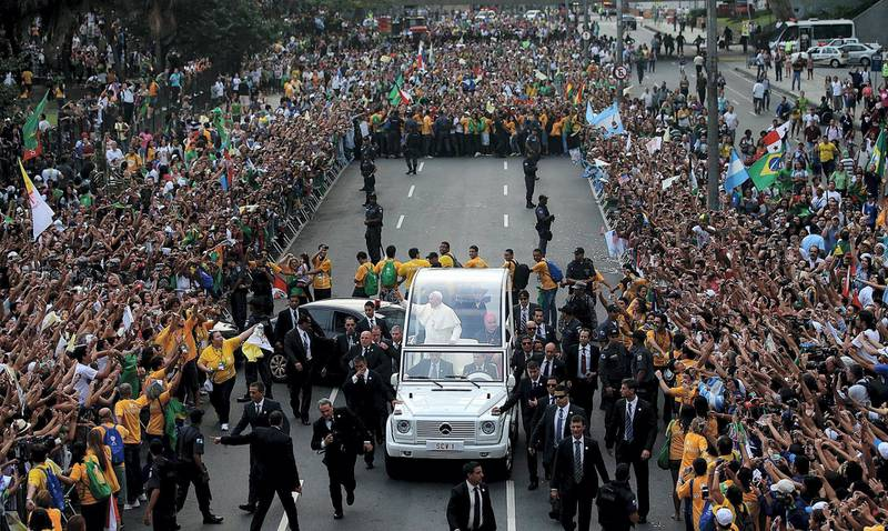 RIO DE JANEIRO, BRAZIL - JULY 22:  Pope Francis (BOTTOM C) waves to the crowd while departing the Metropolitan Cathedral in the Popemobile after arriving in Rio on July 22, 2013 in Rio de Janeiro, Brazil. More than 1.5 million pilgrims are expected to join Pope Francis for his visit to the Catholic Church's World Youth Day celebrations. Pope Francis is scheduled to visit Brazil from July 22 to 28.  (Photo by Mario Tama/Getty Images)
