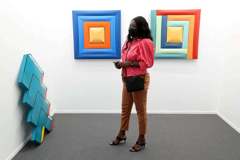 Dubai, United Arab Emirates - Reporter: Alexandra Chaves. Arts and Lifestyle. A visitor looks at a pieces by Shaikha Al Mazrou. Art Dubai 2021 opens at the DIFC. Tuesday, March 30th, 2021. Dubai. Chris Whiteoak / The National